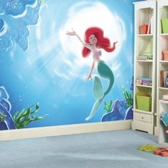 """Put your child's passion for Disney Princesses on display with this The Little Mermaid """"Part of Your World"""" XL Chair Rail Prepasted Mural. Featuring Disney Princess Ariel swimming to the surface of the sea, this wallpaper mural is a must-have for any Disney Dorm, Disney Mural, Casa Disney, Deco Disney, Disney Playroom, Ariel Disney, Little Mermaid Wallpaper, Little Mermaid Room, Mermaid Wallpapers"""