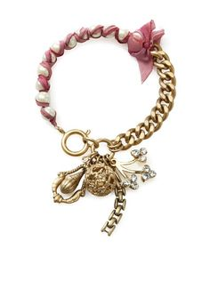 Juicy Couture Jewelry  Event Ends THU APR 26 at 9 AM PT  Festival Chic Girly Cluster Bits Bracelet  Gold-tone metal chain bracelet with pearl-like beads and woven ribbon trim, decorative rhinestone-encrusted girly charms