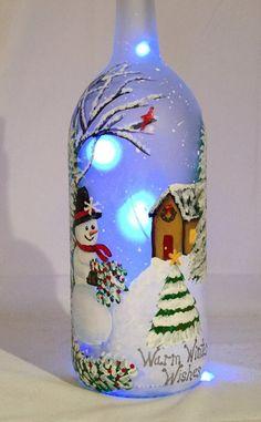 Snowman Wine Bottle- Snowman Wine Bottle Christmas lit bottle of snowman painted wine bottle Wine Bottle Art, Glass Bottle Crafts, Painted Wine Bottles, Lighted Wine Bottles, Diy Bottle, Bottle Lights, Vintage Bottles, Glass Bottles, Beer Bottle