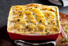 This hearty dish, featuring russet potatoes, onion, garlic and light cheese, is perfect as a tasty side to any main.Courtesy of Black Diamond. Cheddar Potatoes, Russet Potatoes, How To Carmalize Onions, Potato Gratin Recipe, Food Network Recipes, Cooking Recipes, Healthy Homemade Snacks, Food Network Canada, Best Vegetarian Recipes