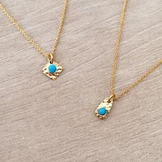 Delicate thin chain necklacefeaturing a tiny gold hammered charm with a turquoise enamel accent.All materials are plated with a thin layer of 24kgold.Choose the length and pendant shape in the dropdown menu.Lobster clasp closure.Nickel-free & lead-free.Handmade in Paris !