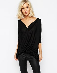 This top is a great alternative to the plan black t-shirts. It's different and have some cool details. Find it here: http://asos.do/aOwDt9