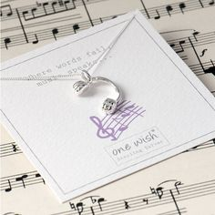 Grace & Valour Headphone Charm Necklace In Sterling Silver ($37) ❤ liked on Polyvore featuring jewelry, necklaces, sterling silver jewellery, sterling silver jewelry, charm jewelry, sterling silver charm necklace and sterling silver charms