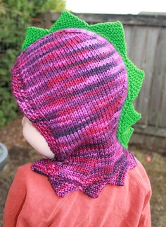 Free knitting pattern for Dinosaur Hood -  Designed by Julia Farwell-Clay, this full hood is designed for a toddler but many knitters have customized it for all ages including adult.