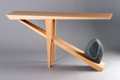 This is something like what I have thought of for a dining room table just on a much smaller scale and with X legs instead of bent wood. Their website has lots more cool stuff combining wood and stone. Seth Rolland - Tables