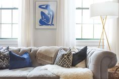 This designer helped a couple pick out furniture that was a balance of both of their styles.