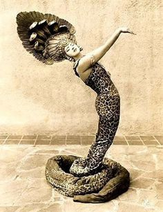 Dancer as a snake.  Is this Ruth St. Denis?  She did a dance as a snake charmer....