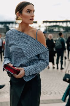 Off the shoulder pinstripe top paired with a statement earring