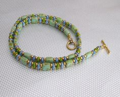 Hey, I found this really awesome Etsy listing at https://www.etsy.com/listing/222528007/green-tila-wrap-bracelet-bead-bracelet
