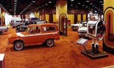 1976 Chicago Auto Show. Photograph of the Ford truck exhibit on the lower level of McCormick Place East. In the center is the 1/2-ton Bronco Ranger 4x4 sport utility wagon. On the right is Freddie Ford, a likable robot, constructed of parts from Ford vehicles. Freddie could see, hear, and answer questions.