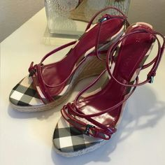 Authentic Burberry Leather Wedge Sandal Women's authentic, Burberry, patent leather, wedge, strappy sandals size 9. Beautiful, burgundy/deep berry color with the trademark Burberry plaid! Barely used, like new! Only worn a couple times. Only wear is on the soles, which is minimal,  as seen in the pictures.  Similar styles sell new for approximately $450. Free shipping! Burberry Shoes Wedges