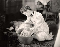 Woman Washing a Baby, early 1900s