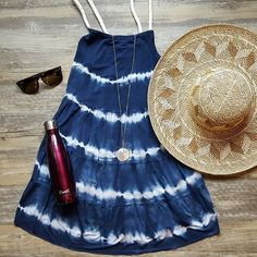Everything you could want for a beautiful beach day! A flirty dress, a sun hat, ice cold water and some cute shades! Swing by the shop to see these items and much more! #beachvacay #whattopack #vacayslay #beachcoverup #stayhip #vacationdestination #throwonandgo #howtowearit #atlantashopping #springready