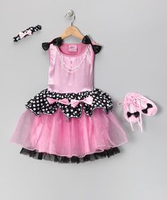 This complete ensemble is the perfect party attire because it's a party all in itself! The decadent dress boasts a poufy skirt and satiny fabric with bow and pearl accents, which pairs preciously with the coordinating ballet flats and stretchy bow headband.Includes dress, headband, ballet flats and satin hanger100% polyesterHand washImported