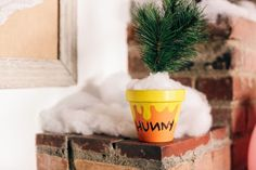 "A Pooh Bear loves his hunny. Make your own ""hunny"" pots with flower pots and paint."