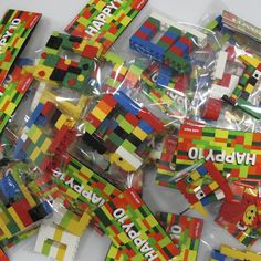 Lego party - instead of buying expensive mini kits as party favors, buy one box and split it up with your own custom bag toppers