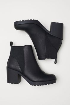 2061c9078ff0 Ankle Boots Ankle boots in faux leather with elastic panels at sides.  Fabric lining