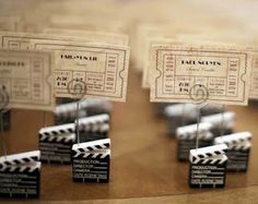 The vintage ticket stub idea for seating I LOVE-but I probably wouldn't use the holders.