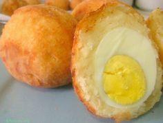 Egg Ball and Cassava Puffs    1 1/2 lb cassava a.k.a yuca    2 tbsp butter    6eggs    salt and black pepper to taste    flour to roll balls in