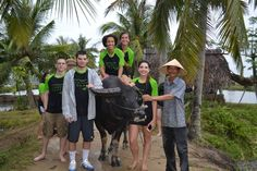 Group shot with their new friend. #VietnamSchoolTours #BuffaloRiding #EcoTours #Hoian