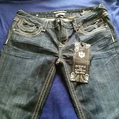 Be Rock do Express Jeans Barely Boot size 12L jeans with back pocket detail. Dark wash with tan stiching. Express Jeans Boot Cut