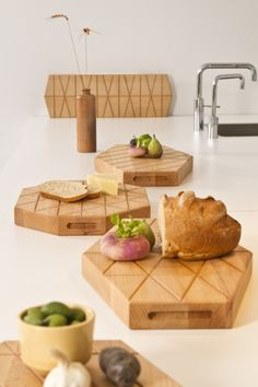 Grid Plank is a minimalist design created by Netherlands-based designer Daphna Laurens. The shapes of all four 'cut and serve' Grid Planks originate from Daphna Laurens' grid studies, one of many methods for the design studio to devise form and shape. (1)