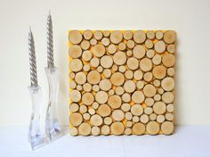 This artwork is made from sliced tree branches that have fallen in our woods. Each slice is hand-sawn, sanded and with natural/matte finish. Background color: medium yellow  Size: 40 cm (16 inch) x 40 cm (16 inch) x 3,5 cm (1-3/8 inch)  Custom orders are welcome! We can design a piece with any background color and size that suit your interiors. So please contact us for estimated designs and sizes.  International shipping available, please ask for shipping costs.  Thank you for looking