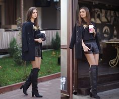 Black boots, black coat, shorts, clutch