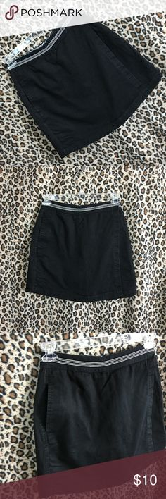 Womens Skort Wrap Skirt Shorts Black Pockets Sport Womens / Juniors Skorts (wrap skirt with attached shorts underneath) Size 8 Black with black and white trim Front zipper Pockets 100% Cotton Retails $30 Very good condition with light fading. No holes, stains or rips.  Thank you for stopping by. Please check out our other items to BUNDLE and SAVE! Basic Editions Skirts Midi