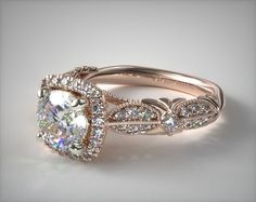 TOP THREE: SKU 52693 - A modern vintage ring,  decorated with delicate milgrain arches and small rows of pave set  diamonds create a dramatic feel to this cushion halo outline engagement ring. * Only available with shapes and sizes shown.