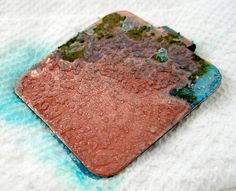 In a glass container, mix 3 Tablespoons of vinegar and 3 teaspoons of saltThen add your copper pendant to the mixture in the bowl, and let it soak for at least 30 minutes:    Remove your pendant from the bowl and lay it out on a folded paper towel.    Don't dry it off or blot away the moisture. It needs to air-dry naturally  Check on your pendant after an hour or so. You should have some color developing:You can sprinkle a small amount of salt on your pendant to help speed things along.