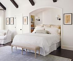 A clever niche cocoons the bed in the bedroom! Click through for more looks here: http://www.bhg.com/decorating/decorating-photos/bedroom/spacious-space/?socsrc=bhgpin020315spaciousspace&bedroom