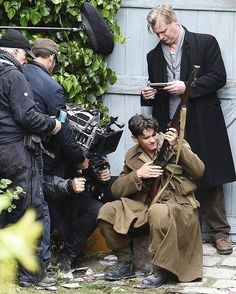 May 24: Young English actor, Fionn Whitehead fires a gun on the set with director, Christopher Nolan. @thedunkirkfilm/instagram