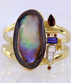 Jennifer Kalled, Yowah opal cuff bracelet in 22k and 18k gold with accents of pearl, tanzanite, & zircon. Opal from Bill Kasso www.kalledjewelrystudio.com