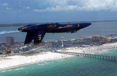 Wow! What an awesome picture this is of the US Navy Blue Angels flying over Pensacola Beach!