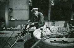 Chief Petty Officer Ken Smith jointing a cable on the deck of HMS St Margarets, 1947