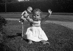 New York baby with doll...