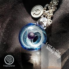 Check out this item in my Etsy shop https://www.etsy.com/hk-en/listing/556877607/hand-blown-glass-pendant-with-necklace