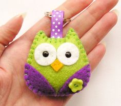 This cute little owl key ring is designed and hand sewn by me using felt. She has colourful wings which have a coordinating flower button sewn on and