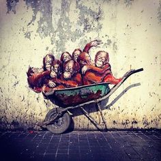Mural by Ernest Zacharevic in Kuching, Malaysia