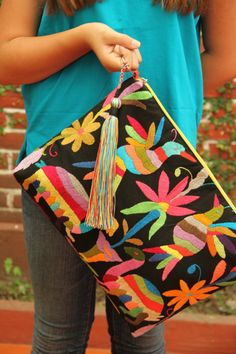 Black and multi colored Clutch Vegan by CasaOtomi on Etsy Mexico, Tenango, mexican wedding, textile, mexican suzani, suzani, embroidery, hand embroidered, otomi, www.casaotomi.com, otomi, table runner, fiber art, mexican, handmade, original, authetic, textile , mexico casa, mexican decor, mexican interior, frida, kahlo, mexican folk,  folk art, mexican house, mexican home, puebla collection, las flores, travel tote, boho, tote, handbag, purse, cushion, pillow, dad of dead, skull, art, dia de los Diy Bags, Cushion Pillow, Travel Tote, Skull Art, Mexican Embroidery, Hand Embroidery, Oaxaca, Mexican Textiles, Diy Pochette