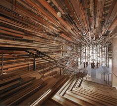 March Studio adds thousands of sticks to staircase of Canberra hotel. (via March Studio adds thousands of sticks to staircase of Canberra hotel) A As Architecture, Cabinet D Architecture, Australian Architecture, Architecture Interiors, Modern Staircase, Grand Staircase, Staircase Design, Timber Staircase, Grande Cage D'escalier