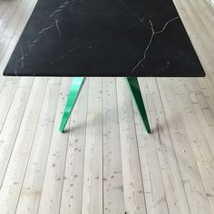 Mesa rectangular table with black marble top with kelly green legs. One of our favourites designed by @45_kilo