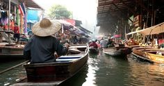 Wooden boats ferrying people at Amphawa floating market | Journey to Thailand
