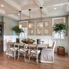 lovely dining room space, natural sea fans framed on the wall and the trees in baskets.