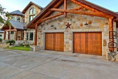 Country Garage with Barn door, Stripped bark truss, Copper star wall decoration, Concrete floors, High ceiling