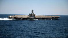 The Nimitz-class aircraft carrier USS Dwight D. Eisenhower (CVN 69) conducts rudder turns during sea trials