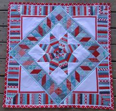 Round 3 of my red and aqua string star Round Robin quilt - I turned it on point!