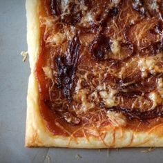 Pumpkin Butter Tart with Caramelized Onions and Smoked White Cheddar.