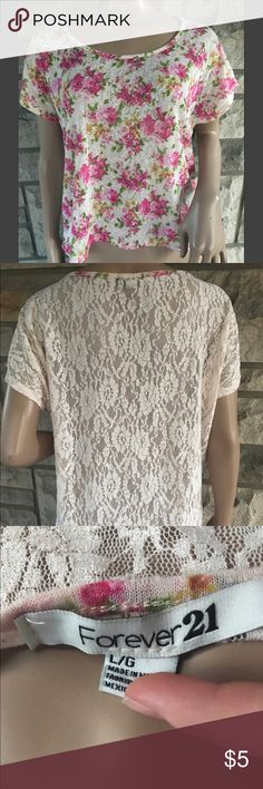 Floral Lace Flower Back The shirt is a floral pattern with a lace back. The back of the shirt is a little long too. It says it's a large but fits flowy for a medium. I'm a small and I even wore it and loved the way it looked. Condition of the shirt is good. Can be worn with some cute jeans or shorts. 100% polyester Tops Tees - Short Sleeve